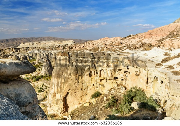 View of cave houses in rock at Cavusin. Cappadocia. Nevsehir Province. Turkey
