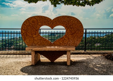 View from the center of San Giorgio with a heart-shaped bench, Valpolicella. Verona - Italy