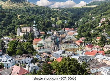 View of the center Slovak mining town Banska Stiavnica with Old Castle and Holy Trinity Square .