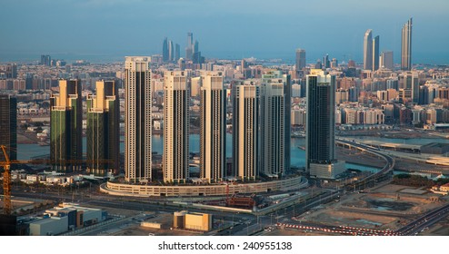 View to the center of the town of Abu Dhabi (capital of United Arab Emirates). Office & apratment buildings. Persian Gulf at far horizon.