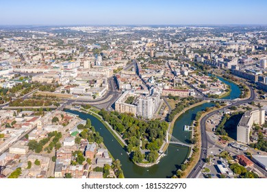 View of the central part of the city of Kharkov. Strelka square on the bank of the Lopan River. View from a height of 500 meters. Sunny weather.