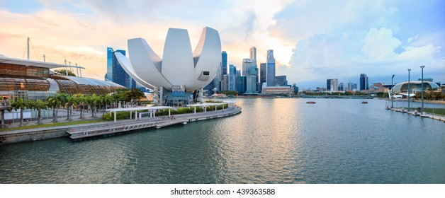 View of central Singapore. ArtScience lotus flower museum with promenade, Marina Bay Sands shopping mall, Esplanade theatres and One Fullerton hotel