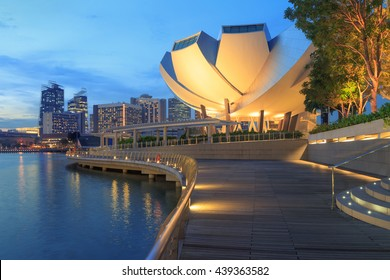 View of central Singapore. Bayfront Ave promenade, ArtScience lotus flower museum, Esplanade theatres glowing at night