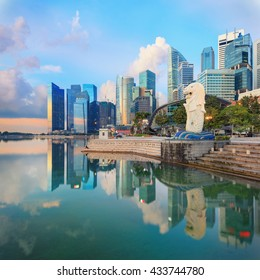 View of central Singapore. Merlion lion fountain sculpture with One Fullerton hotel and financial towers on background.
