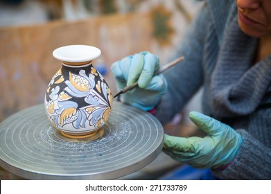 View of a ceramic vase from Caltagirone being decorated by a local artisan