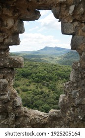 A view Ceze valley in that Gard , through a broken wall of the medieval templar castle in Allegre les fumade - Shutterstock ID 1925205164