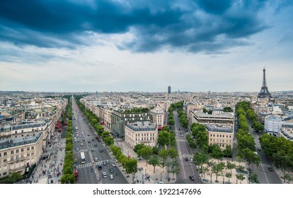 View of the Champs-Elysees with the The Eiffel Tower in the background, seen from the Arc de Triomphe in the afternoon
