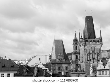 View of Charles bridge (Karluv Most) Lesser Town Bridge Tower and the tower of the Judith Bridge in black and white colors. Prague, Czech Republic.