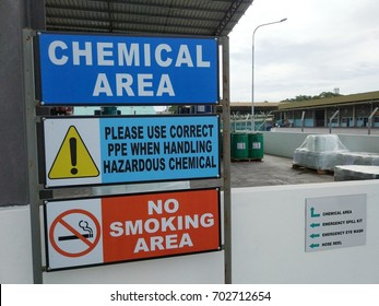 View of of chemical storage area safety signage with reminder on personel protective equipment (ppe) and no smoking.