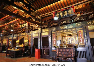 View of Cheng Hoon Teng temple in Malacca Malaysia. Interior of the red religious building with decorations and priers. Lanterns are suspended. The picture has been taken on 1st august 2015.