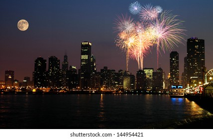 View of Chicago downtown and Navy Pier with grand fireworks and super moon