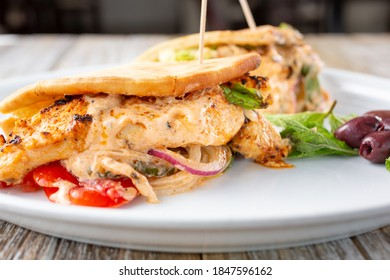 A view of a chicken kabob pita wrap.
