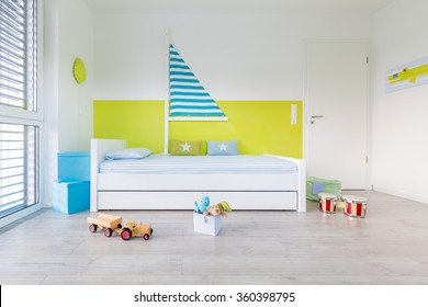 View in Children's playroom with a bed an large window