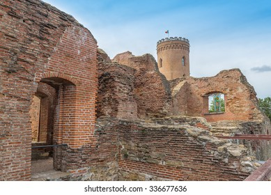 View of The Chindia Tower (Turnul Chindiei in romanian) between ruins and old walls of Princely Court, in Targoviste, Romania, The Real Palace of Vlad Tepes, built in the 15th century.