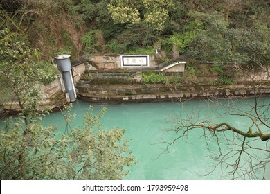 "View of Chinese ancient irrigation system Dujiangyan Bottleneck Channel (Chinese: Baopingkou) in Dujiangyan, Sichuan, China.  Translation on wall text ""Bottleneck Channel ""."