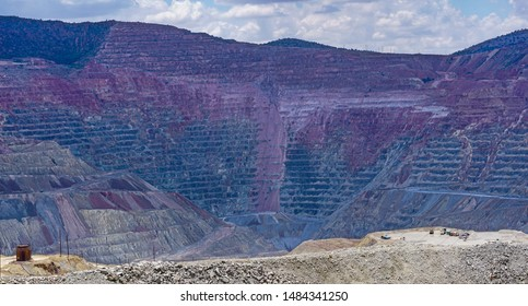 View of Chino open pit copper mine in Santa Rita, New Mexico, east of Silver City. Vehicles in right foreground show scale of the mile-wide excavation.