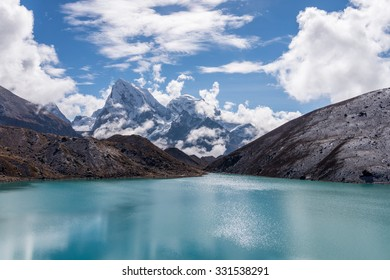 View of Cholatse and Taboche peaks and turquoise water of Gokyo lake (Dudh Pokhari) in Everest region, Nepal