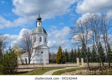 View of the Christian church on the background of the spring blue sky with clouds