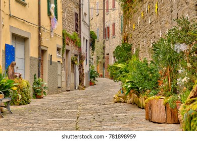 view of Christmas decorations in picturesque street of cozy Italian medieval village