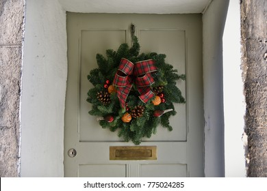 View of a Christmas Wreath on a House Door
