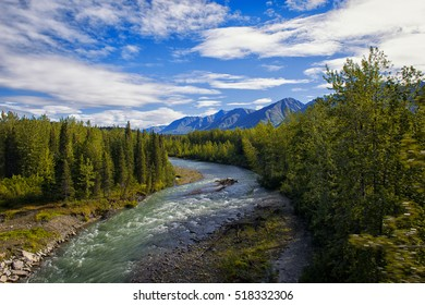 View of Chulitna River in Alaska on a bright summer day.
