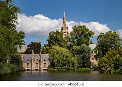 View to a church across a pond. Bruges, Belgium