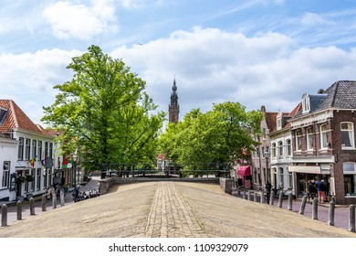 view of church dome over a covered canal in the center of the edam vila. netherlands