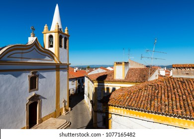 View of a church and houses in the traditional village of Nisa in Alentejo, Portugal; Concept for travel in Portugal and visit Portugal