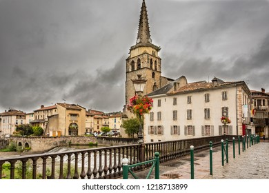 View of the Church from the old bridge over the river Salat in the village Saint Girons. Ariege France