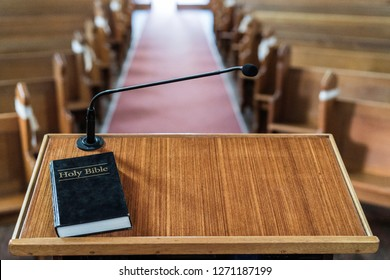 view of church pulpit with bible on it, overlooking the church