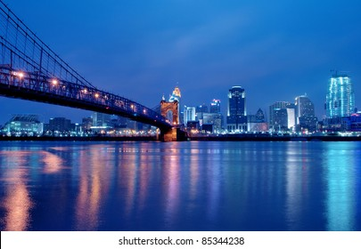 A view of Cincinnati, Ohio?s skyline cityscape overlooking the Ohio River at night.
