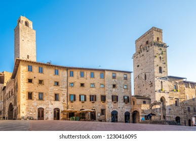 View at the Cisterna place with Tower of Devil (Torre del Diavolo) in San Gimignano, Italy