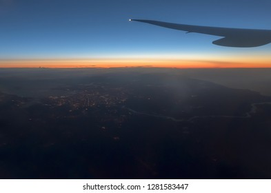 View of the city from an aircraft after sunset.