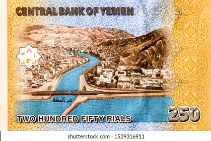 View of the city of Al Mukalla and the estuary, Hadramaut. portrait from Yemen 250 Rials 2009 bank note. Yemen money, Yemen bank notes. Closeup Uncirculated - Collection