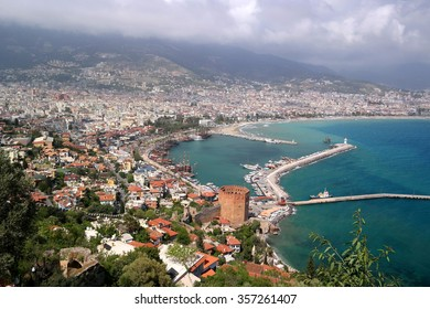 View of the city of Alanya, castle, red tower, dock, ships