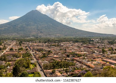 View of the city of Antigua, Guatemala with Volcan de Agua behind in Central America