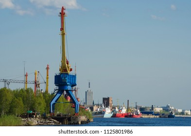 A view of the city of Arkhangelsk from the side of the river. Port and high-rise buildings