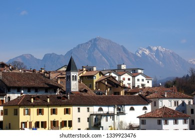 View of the city of Belluno with the Dolomites in the background