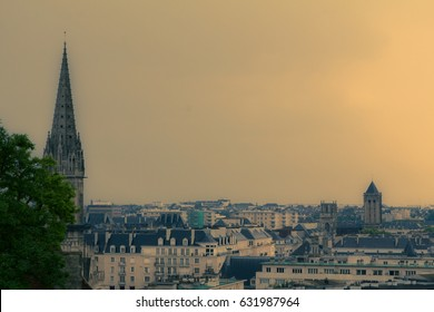View of the city of Caen under the storm from the heights of the castle