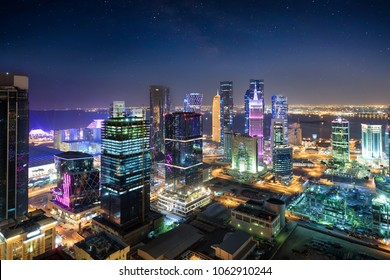 View to the city center of Doha, Westbay, Qatar, by night with starry sky