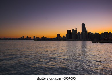 View of city Chicago from the water during sunset and at night