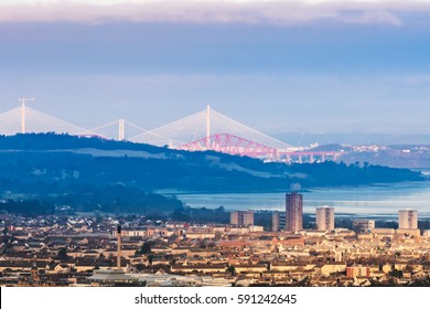 View of the City of Edinburgh with the Firth of Forth and the Forth Bridges - including the new Queensferry Crossing - at the background at sunrise. Edinburgh, Scotland, United Kingdom