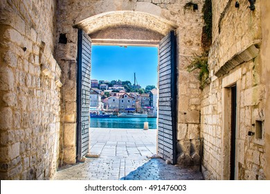 View at city gate in old mediterranean town Trogir, Croatia Europe. / City gate Trogir. / Selective focus.