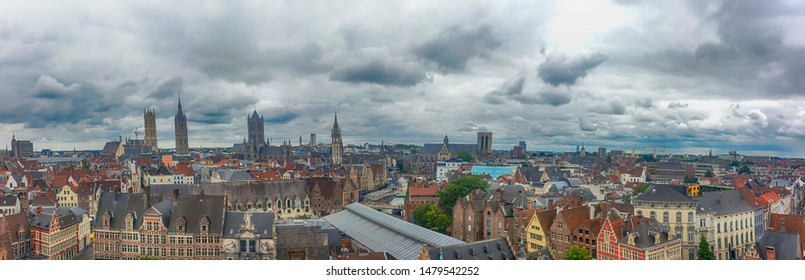 View of the city of Gent from the tower of the Gravensteen Castle of the Count of Flanders on the background of   expressive cloudy sky. Ghent is the capital of the province of East Flanders.  Belgium