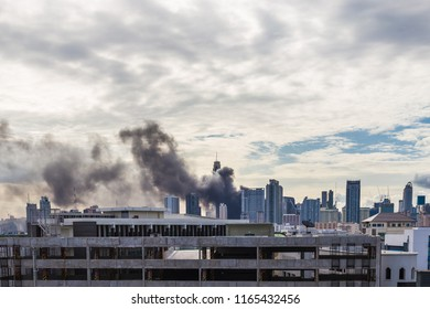 View of city with huge dark smoke fires and explosion