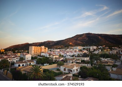 View to the city just before sunset. Albir, Spain.