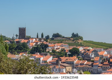 View at the city Lamego downtown and as background the tower at Castle of Lamego, an iconic monument building on the top at the city, portuguese patrimony
