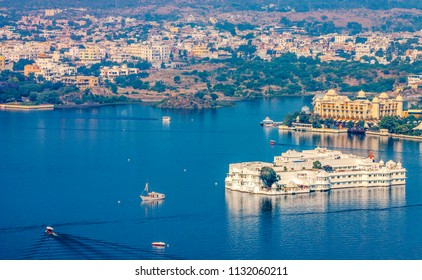 View of the city landscape of Udaipur - Lake Pichola and Taj Lake Palace in Udaipur, Rajasthan, India, Asia - Panorama.
