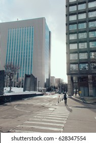 View of city with modern building and snow on sunset time in Sapporo city