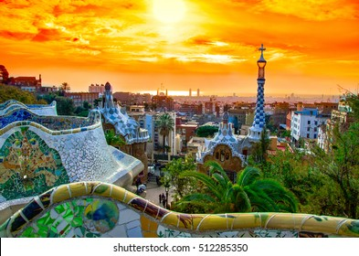 View of the city from Park Guell in Barcelona, Spain with sunrise colors.